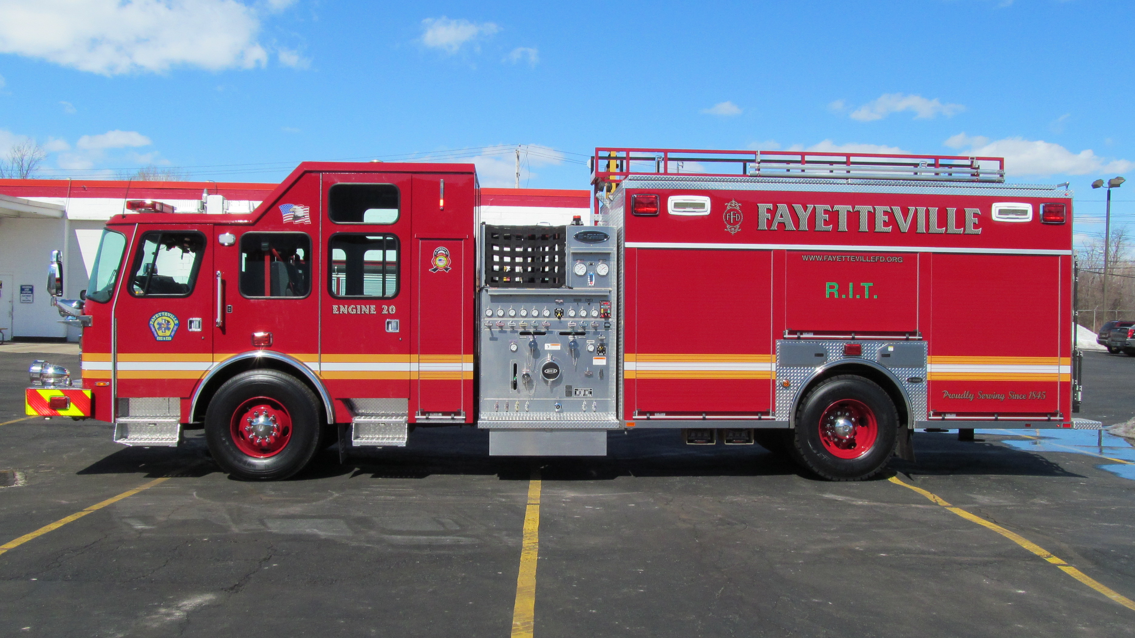 E-ONE Stainless Pumper - Driver side